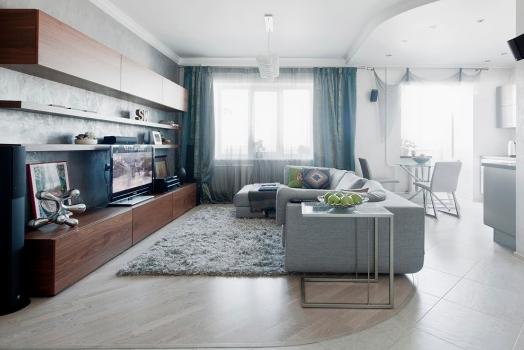 Сочетание серого и бирюзового в гостиной